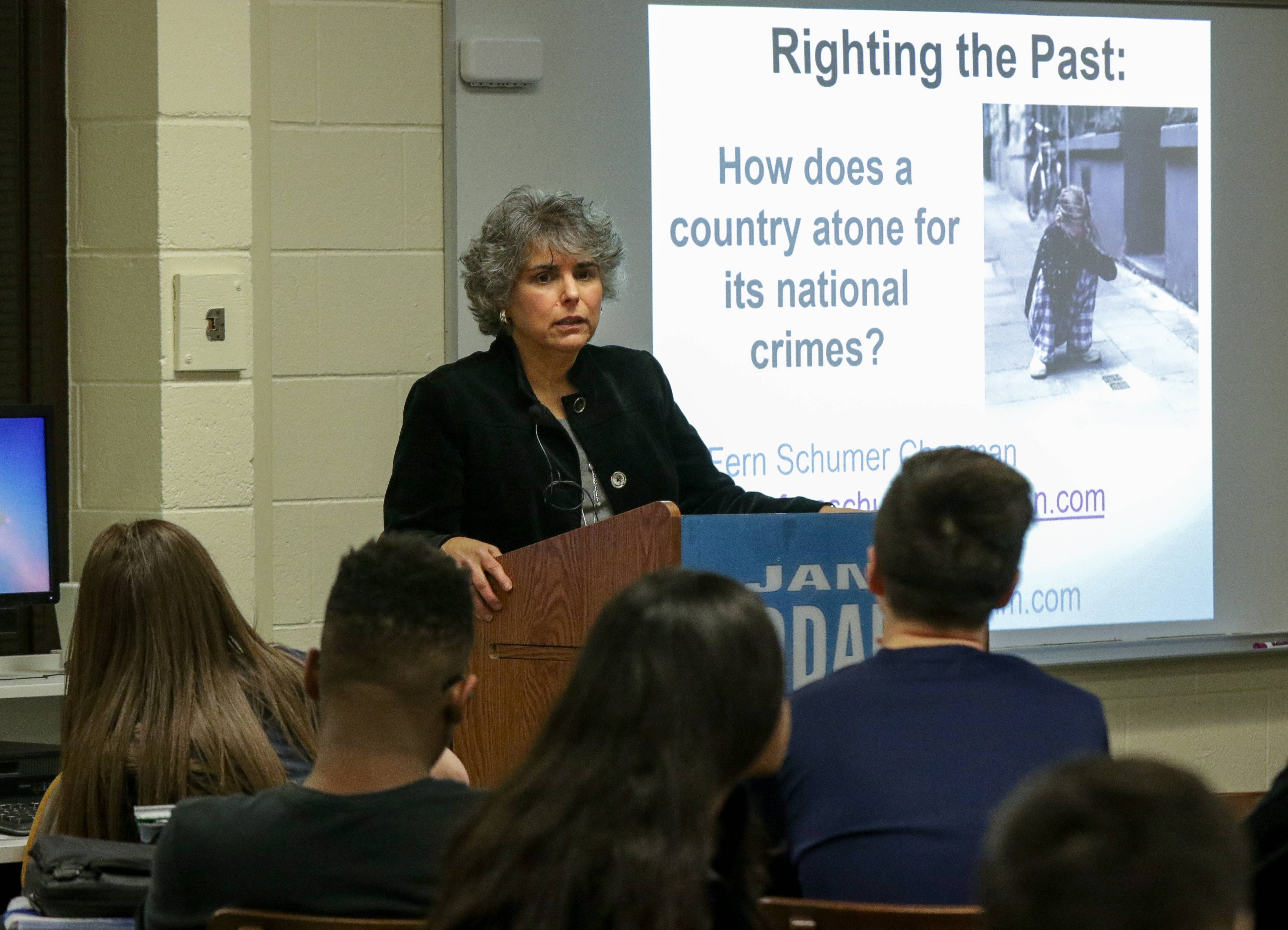 Fern Schumer Chapman talks about atonement at Addams Junior High in Schaumburg on Friday. She and her mother spoke to eighth-graders about surviving the Holocaust.
