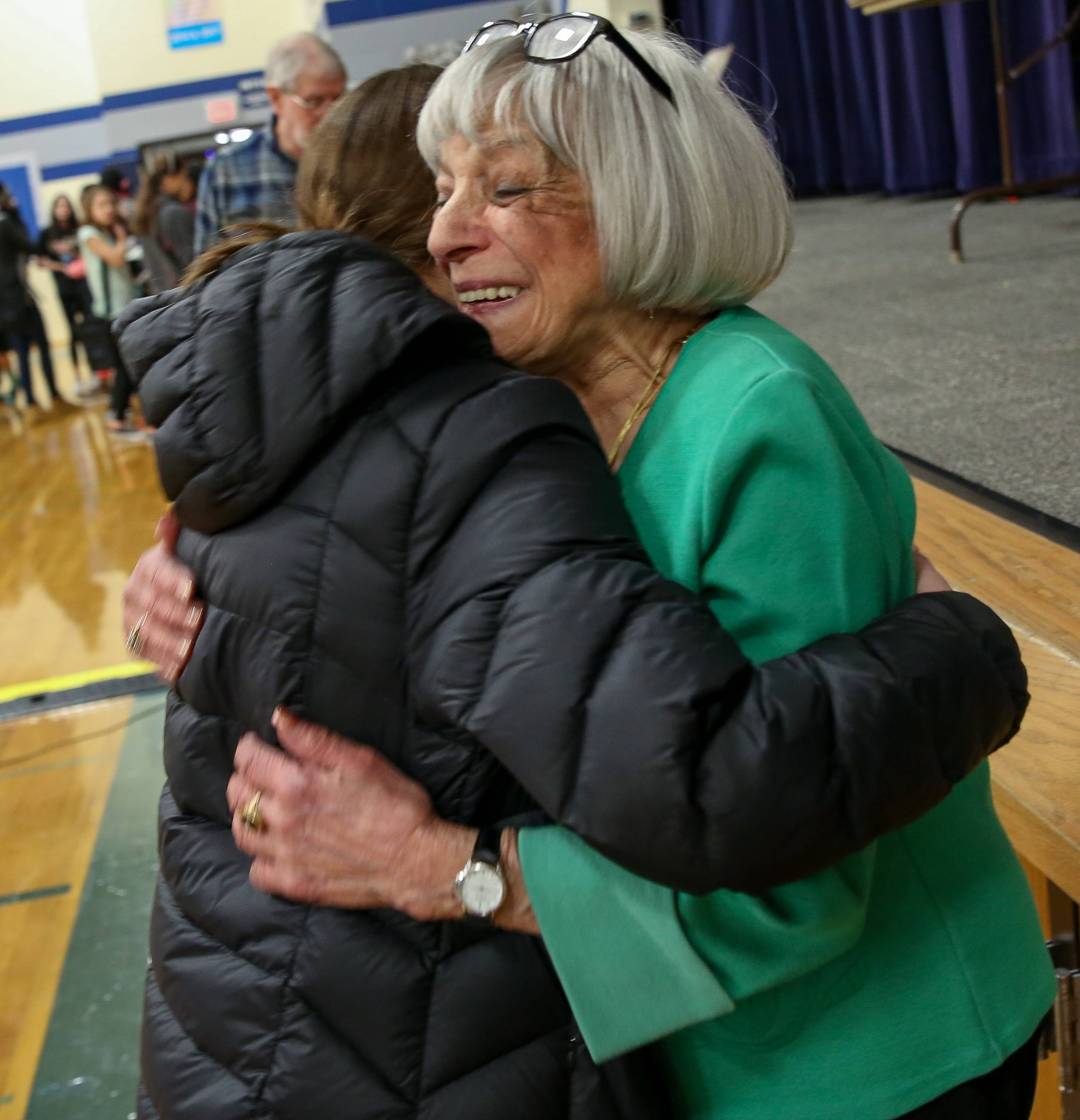 Edith Westerfeld Schumer, 92, gives eighth-grader Vivian Santana a hug after speaking to students at Addams Junior High in Schaumburg Friday about Schumer's escape from the Holocaust.