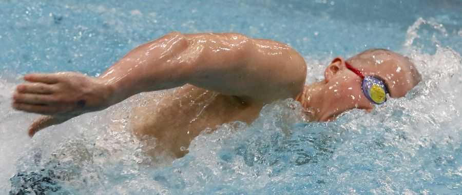 Stevenson's Ethan Ross swims the 200-yard freestyle Friday during the boys swimming state meet prelims at Evanston.
