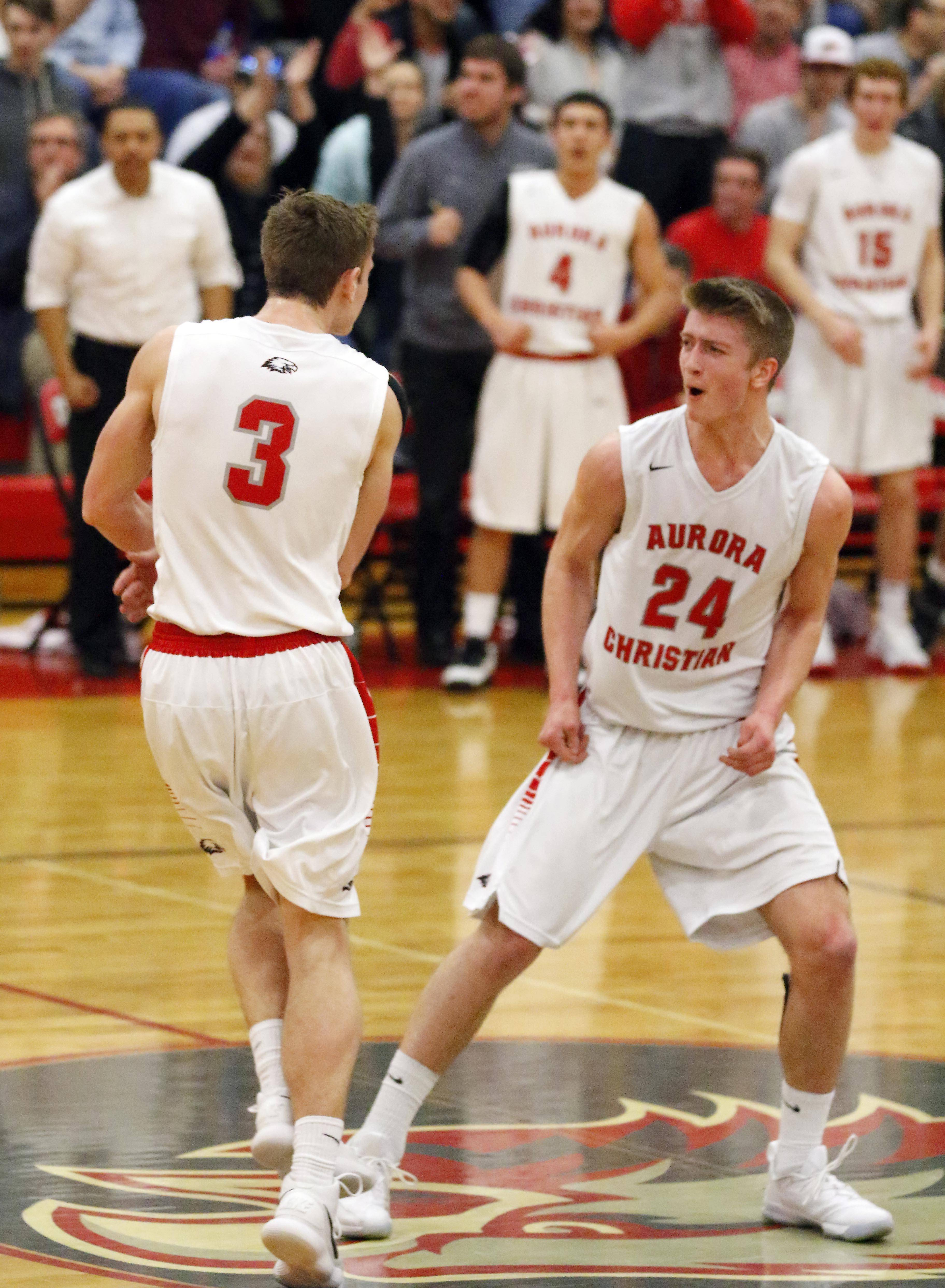 Aurora Christian's Jake Wolfe (3) and Will Wolfe (24) celebrate a three-point basket.
