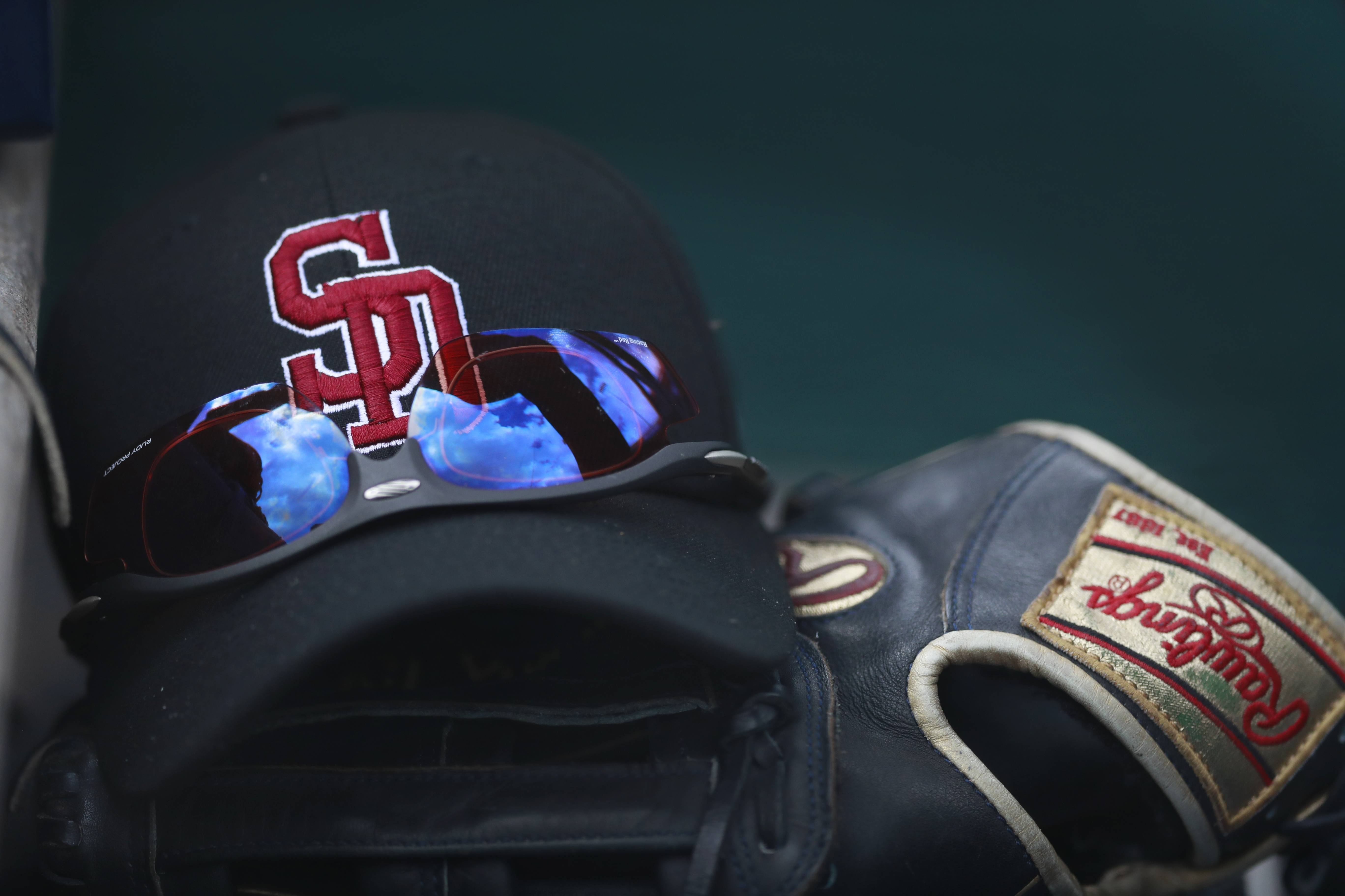 Anthony Rizzo and the Chicago Cubs said they were proud Friday to wear the baseball caps of Rizzo's alma mater, Stoneman Douglas High School, scene of a mass shooting last week.