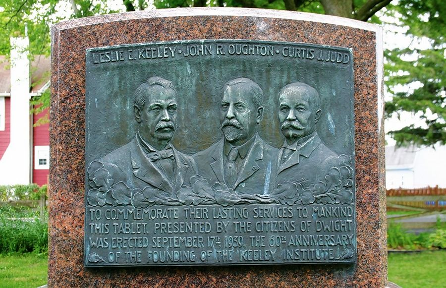 Founders of the Keeley Institute are, from left, Leslie E. Keeley, John R. Oughton and Curtis J. Judd. This plaque was installed in 1939 on the grounds of the Country Mansion restaurant in Dwight.