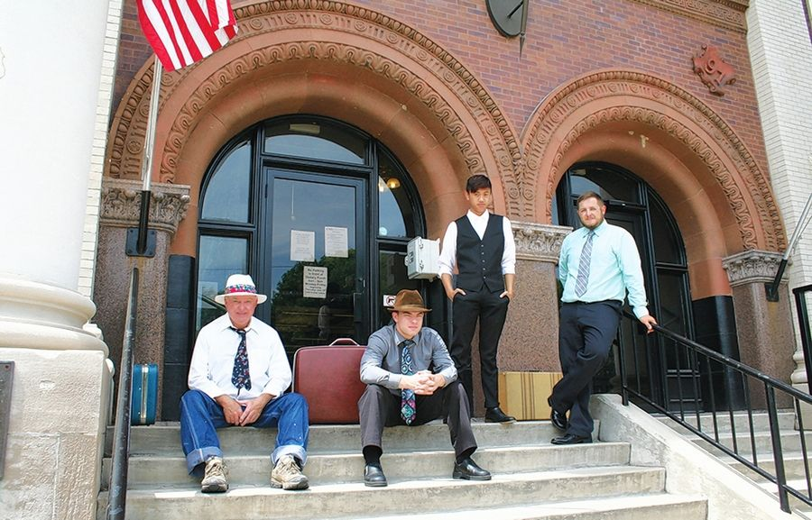 During a Dwight Historical Society Keeley Day bus tour, from left, Don Ahearn, Ryan Beier, Marc Rosales and John Krischel portray Keeley Institute patients waiting for the train to take them home.
