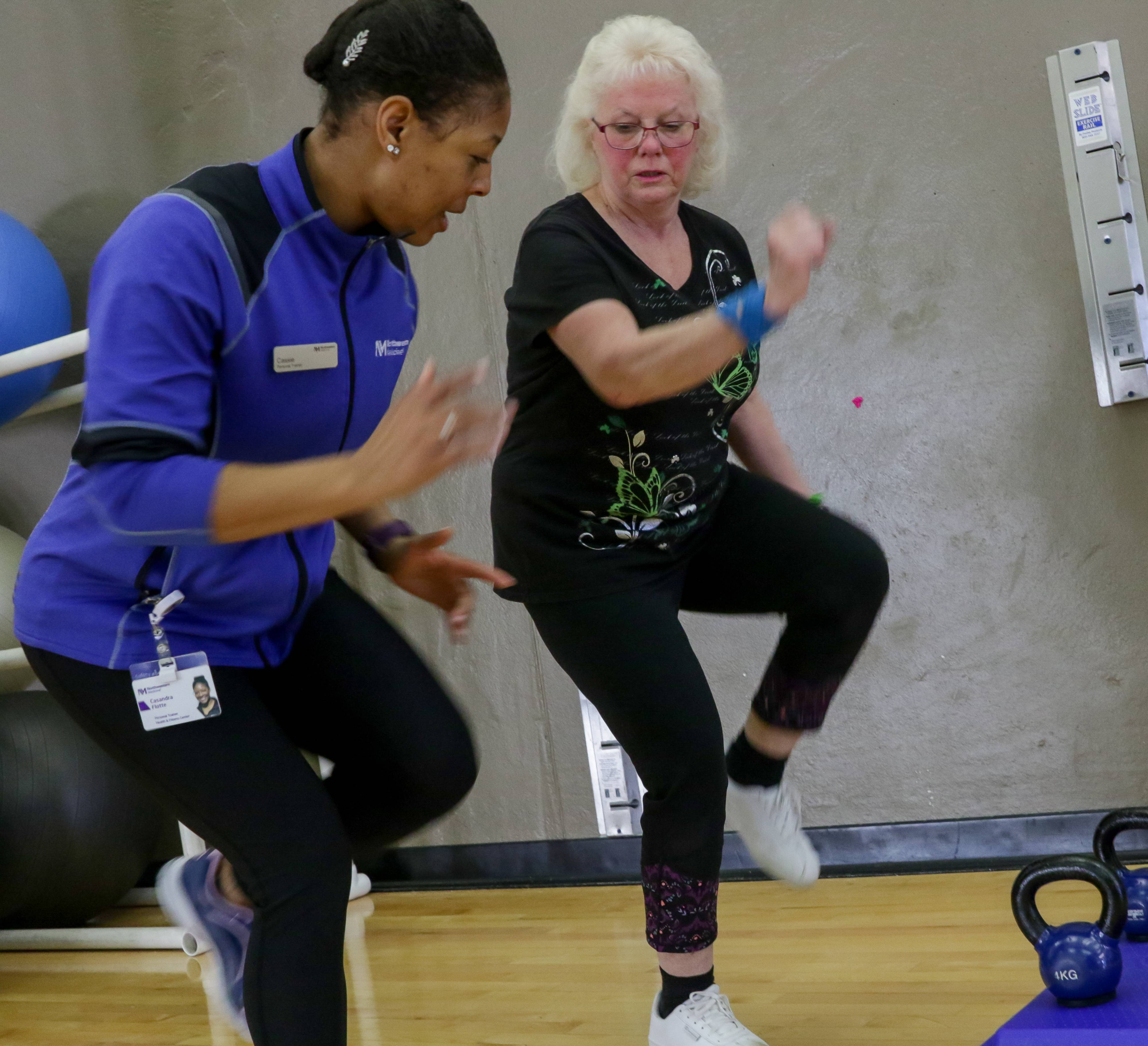 Michele Golden of Batavia, right, works out with fitness specialist Cassie Flotte at Delnor Health & Wellness Center in Geneva. Six months ago, Golden couldn't walk in her house without stopping to rest.
