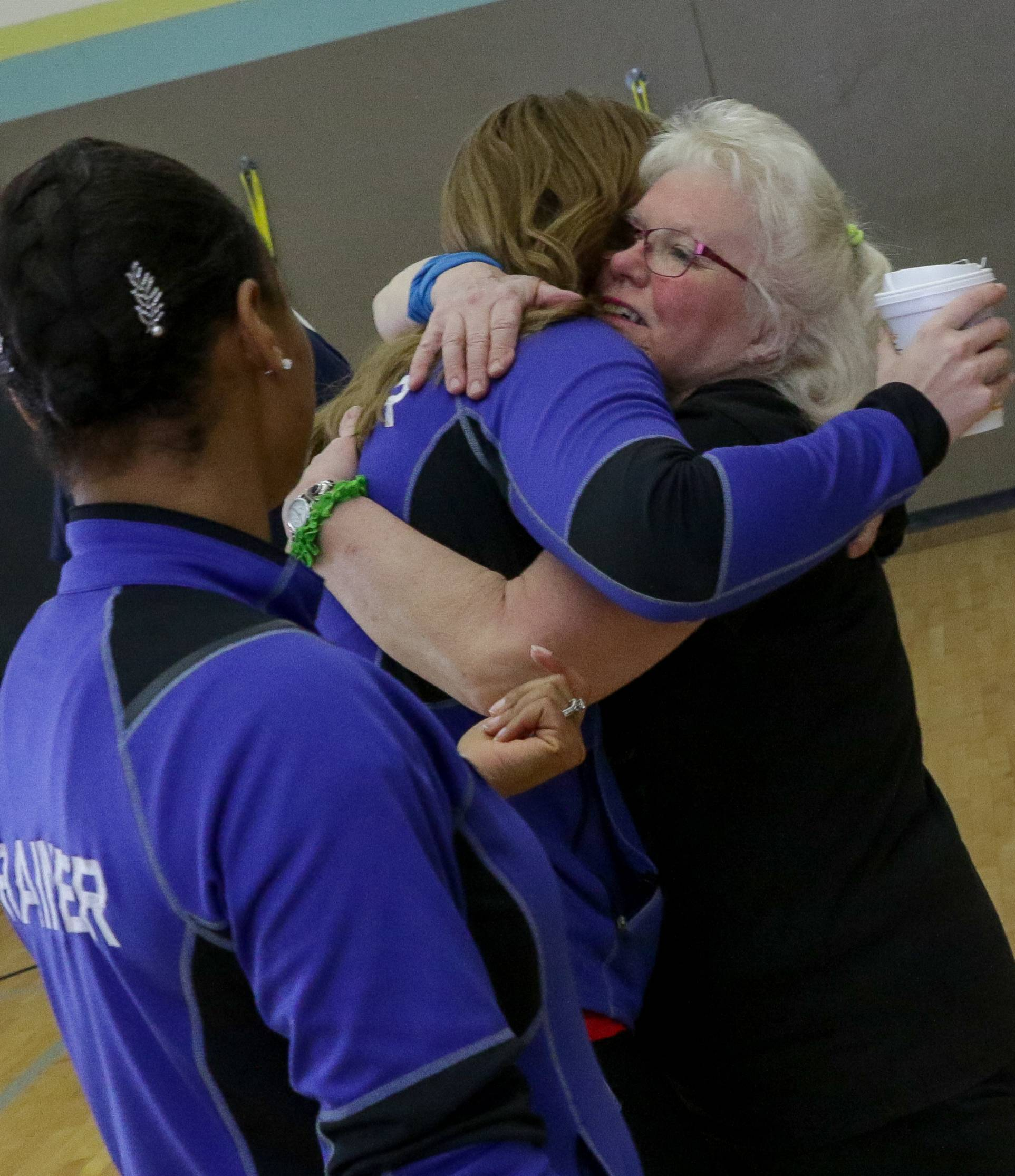 A new woman since doctors inserted a MitraClip into her heart, Michele Golden of Batavia gives a hug to personal trainer Monica Green at Delnor Health & Wellness Center in Geneva.