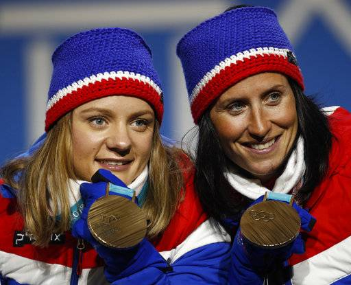 Bronze medalist in the women's team sprint freestyle cross-country skiing Marit Bjoergen and Maiken Caspersen Falla, of Norway, pose during the medals ceremony at the 2018 Winter Olympics in Pyeongchang, South Korea, Thursday, Feb. 22, 2018.