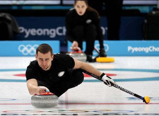 FILE - In this Feb. 7, 2018, file photo, Russian curler Alexander Krushelnitsky practices ahead of the 2018 Winter Olympics in Gangneung, South Korea. Krushelnitsky was stripped of his Olympic bronze medal after admitting to a doping violation at the Pyeongchang Games. Krushelnitsky tested positive for meldonium, which is believed to help blood circulation, after winning bronze in mixed doubles with his wife, Anastasia Bryzgalova.
