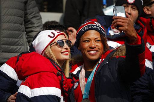 Silver medalist of the women's two-man bobsled, Lauren Gibbs of the United States, right, takes a selfie with Ivanka Trump during the third heat of the four-man bobsled competition final at the 2018 Winter Olympics in Pyeongchang, South Korea, Sunday, Feb. 25, 2018.