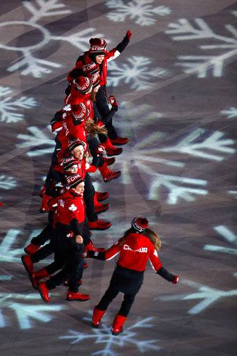 Canadian athletes walk into the stadium during the closing ceremony of the 2018 Winter Olympics in Pyeongchang, South Korea, Sunday, Feb. 25, 2018.