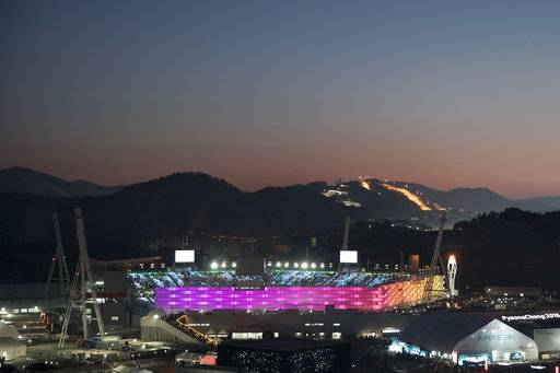 The Olympic Stadium is illuminated prior to the closing ceremony of the 2018 Winter Olympics in Pyeongchang, South Korea, Sunday, Feb. 25, 2018.
