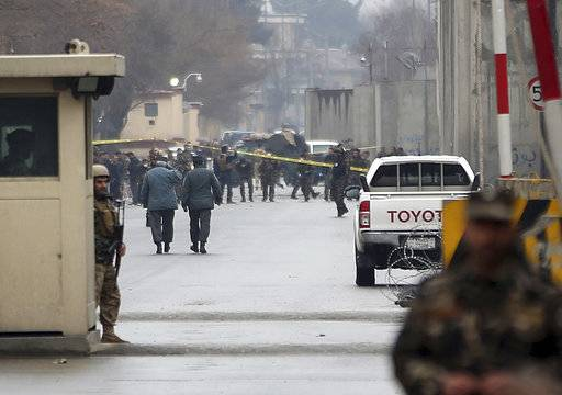 Security forces inspect the site of a suicide bombing in the diplomatic area of capital Kabul, Afghanistan, Saturday, Feb. 24, 2018.  Interior ministry spokesman Najib Danish said several people were wounded in Saturday's attack in the Shash Darak area of Kabul, near NATO headquarters and not far from the U.S. Embassy.