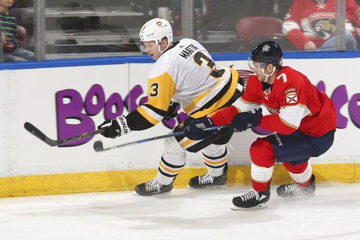 615a1b396e9 Florida Panthers center Colton Sceviour (7) defends against Pittsburgh  Penguins defenseman Olli Maatta (