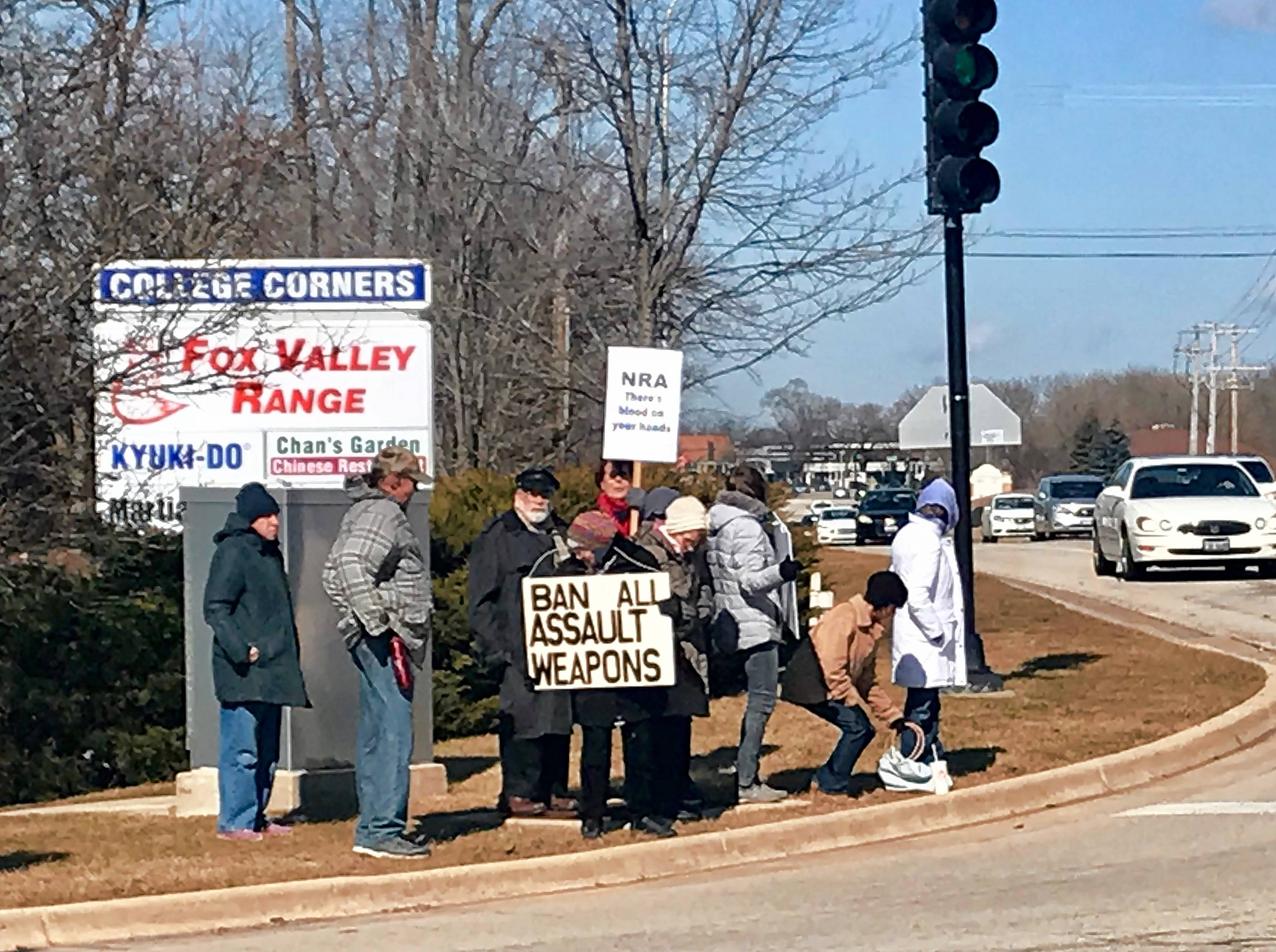 A rally to oppose assault rifles and support stricter gun control was held Sunday at McLean Boulevard and College Green Drive in Elgin.