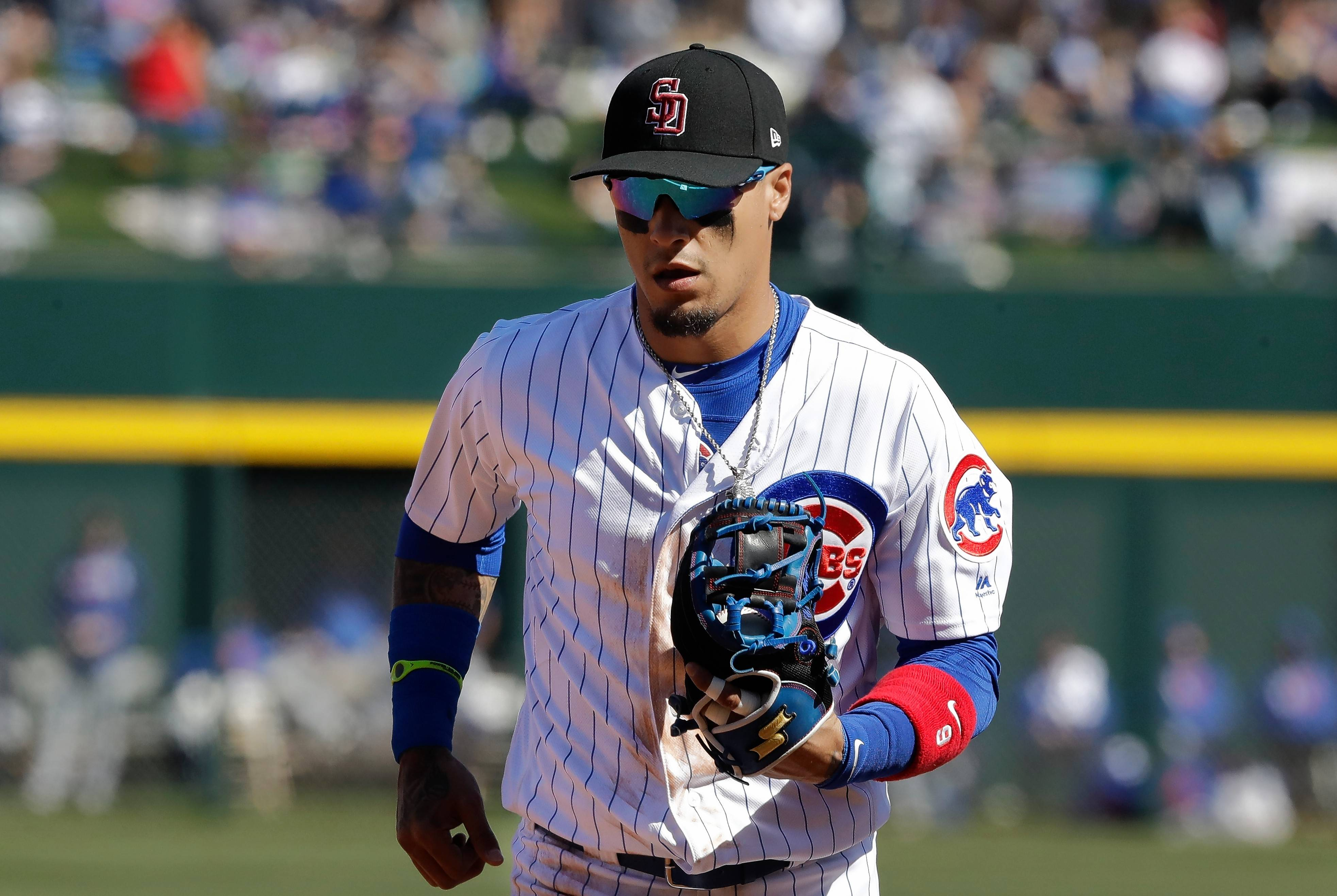 Chicago Cubs' Javier Baez made two strong defense plays against the Texas Rangers on Saturday during the team's second Cactus League game of the spring in Mesa, Ariz.