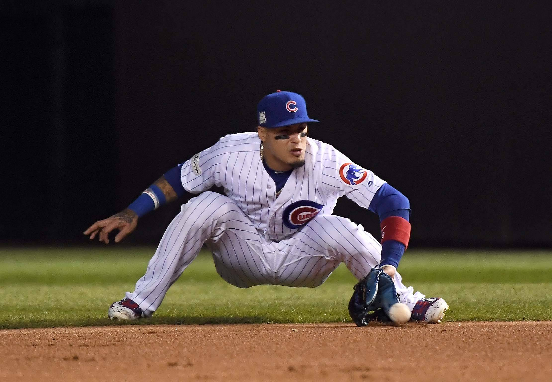 Chicago Cubs second baseman Javier Baez (9) grabs a line drive by Los Angeles Dodgers right fielder Andre Ethier (16) to end the 3rd inning during Game 4 of the National League championship series, Oct, 18 2017, at Wrigley Field in Chicago.