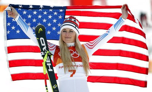 FILE - In this Feb. 21, 2018 file photo, bronze medal winner Lindsey Vonn, of the United States, celebrates during the flower ceremony for the women's downhill at the 2018 Winter Olympics in Jeongseon, South Korea. With Vonn and Ted Ligety likely on the way out, alpine skiing is heading for a major changing of the guard after winning just one gold and three medals at these games.  That was the fewest U.S. victories since 2002, the fewest podium finishes since 2006.