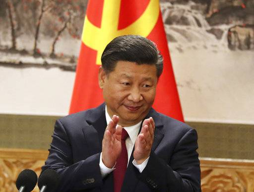 FILE - In this Oct 25, 2017, file photo, Chinese President Xi Jinping claps while addressing the media as he introduces new members of the Politburo Standing Committee at Beijing's Great Hall of the People. On a proposal made public Sunday, Feb. 25, 2018, China's ruling Communist Party proposes removing a limit of two consecutive terms for the president and vice president.