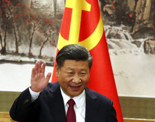 FILE - In this Oct. 25, 2017, file photo, Chinese President Xi Jinping waves while addressing the media as he introduced new members of the Politburo Standing Committee at Beijing's Great Hall of the People. China's official news agency said Sunday, Feb. 25, 2018, the ruling Communist Party proposed removing a limit of two consecutive terms for the country's president and vice president. The move, if approved, appears to lay the groundwork for party leader Xi to rule as president beyond 2023.