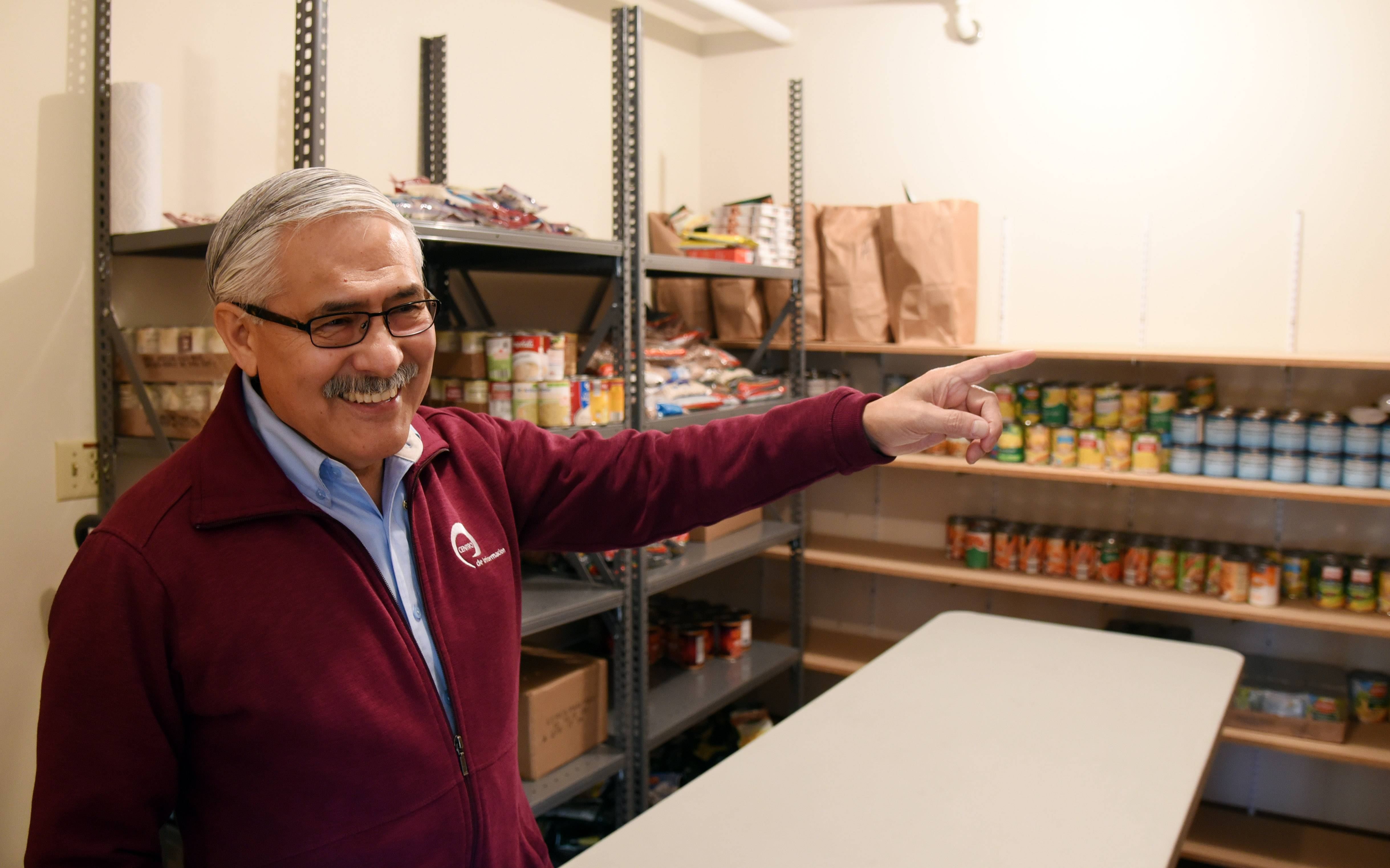 Executive Director Jaime Garcia shows off one of three rooms that house the emergency food bank at the new location of Centro de Informacion in Elgin, which opened Monday at 1885 Lin Lor Lane.