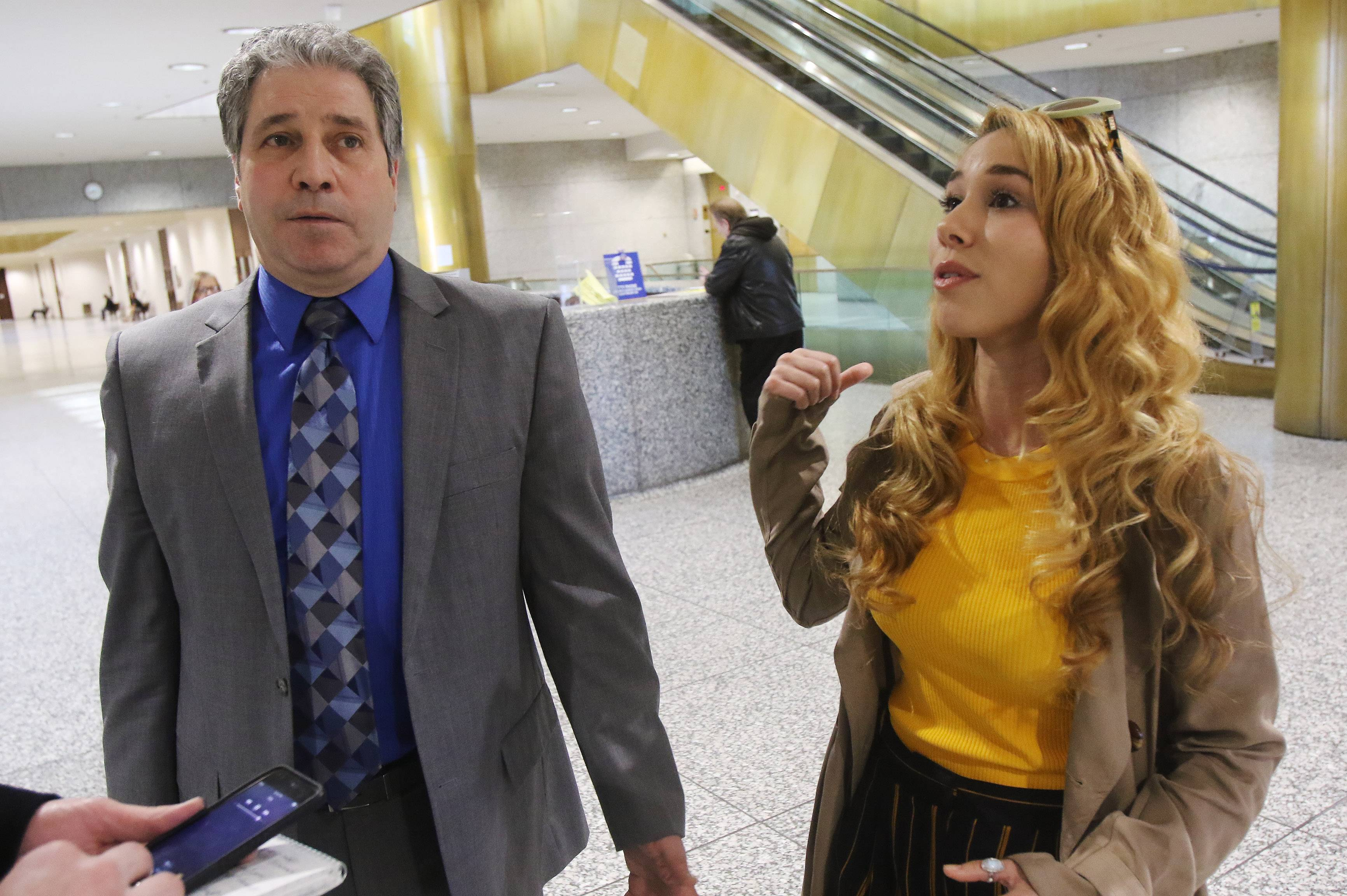 Haley Reinhart and attorney Carmine Trombetta speak with the media Monday after a Cook County judge found her guilty of battery. The local ordinance violation stemmed from a July 8 fracas at a Palatine bar.