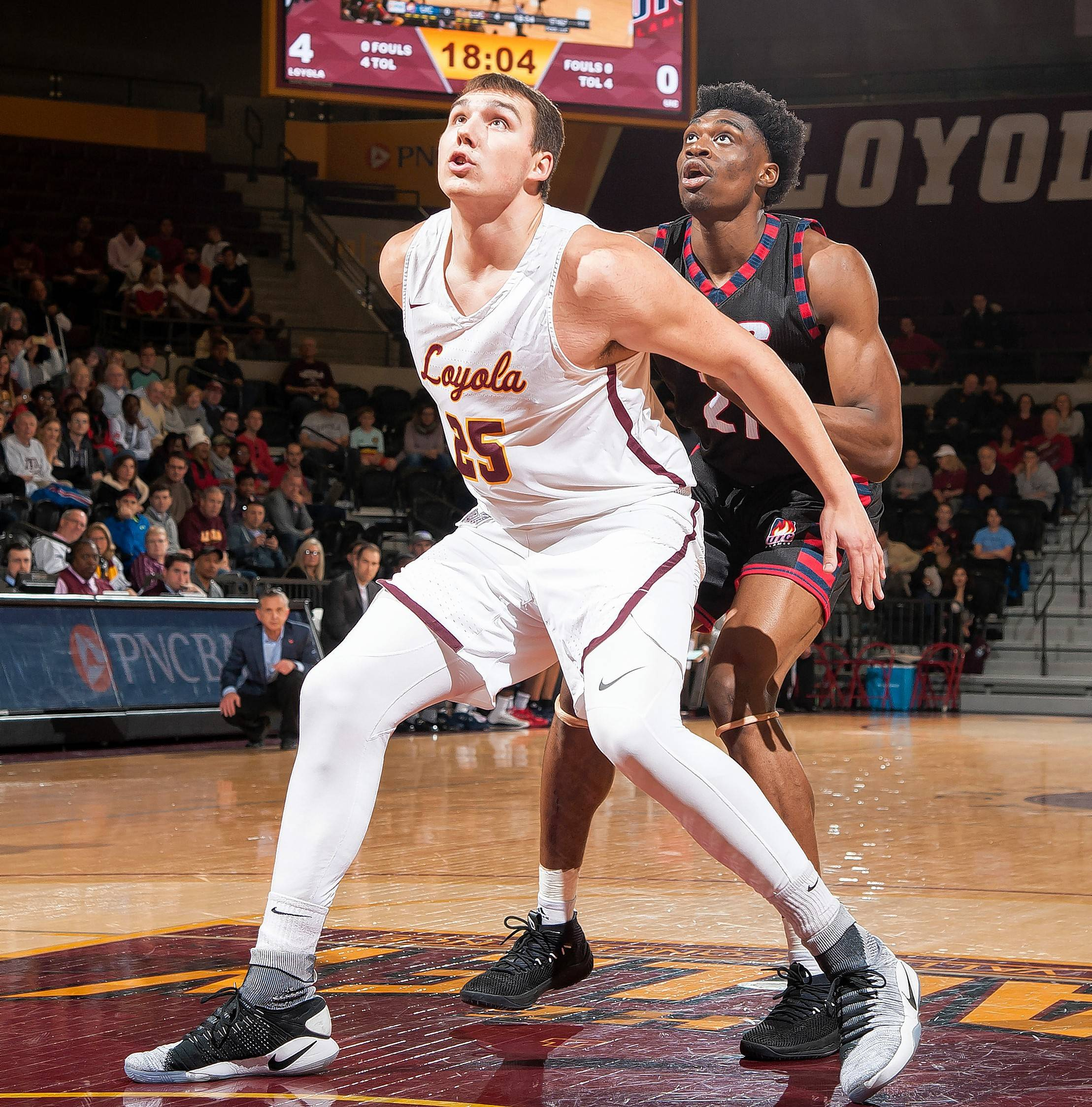 Courtesy of Loyola Athletics/Steve Woltmann Loyola's Cameron Krutwig, a freshman center from Jacobs High School, blocks out in a game against Illinois-Chicago. Krutwig helped Loyola clinch the MVC title last week by averaging 15.5 points and 5.5 rebounds against SIU and Illinois State.