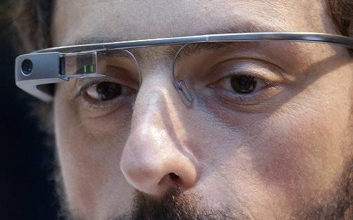 FILE - In this Feb. 20 2013 file photo, Google co-founder Sergey Brin wears a Google Glass device in San Francisco. From AT&T's Alexander Graham Bell to Brin, immigrants have long been more likely than native-born Americans to realize the dream of owning their own company. (AP Photo/Jeff Chiu, File)