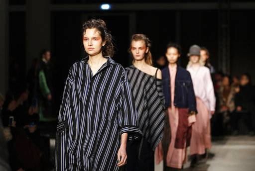 Models wear creations part of Ujoh women's Fall/Winter 2018-2019 collection, presented during the Milan Fashion Week, in Milan, Italy, Monday, Feb. 26, 2018. (AP Photo/Antonio Calanni)