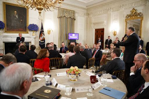 Gov. Jay Inslee, D-Wash., right, speaks about school safety during an event with President Donald Trump and members of the National Governors Association in the State Dining Room of the White House, Monday, Feb. 26, 2018, in Washington. (AP Photo/Evan Vucci)