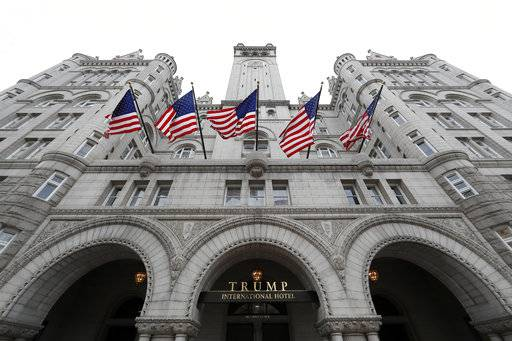 FILE - In this Dec. 21, 2016, file photo, the Trump International Hotel on Pennsylvania Avenue in Washington. A Trump Organization executive says the company has donated an undisclosed amount of profits from foreign government patrons at its hotel properties to the U.S. Treasury, but won't say how much. (AP Photo/Alex Brandon, File)