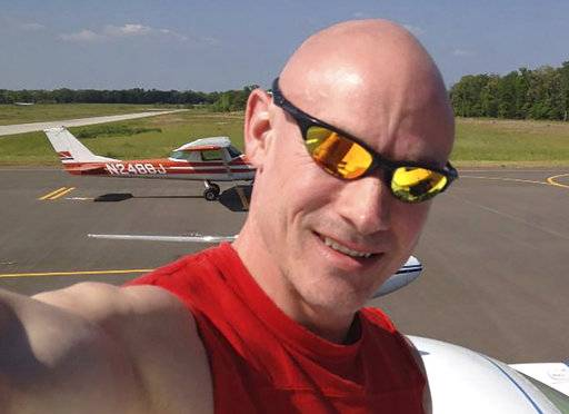 This 2014 photo provided by Melissa Zarda is a selfie by her brother Donald Zarda with his plane in the background at the Wood County Airport Collins Field in Mineola, Texas. Zarda, was a gay skydiving instructor who is the subject of a sex discrimination ruling. He died three years ago in a wingsuit accident in Switzerland, but on Monday, Feb. 26, 2018, a federal appeals court in New York became the second one in the country to declare that U.S. anti-discrimination law protects employees from being fired over their sexual orientation. The decision involved Zarda, who was fired in 2010 from a skydiving job in Central Islip, N.Y., that required him to strap himself tightly to clients so they could jump in tandem from an airplane. To put one female student at ease about the physical contact, he said, he told her not to worry - he was gay. The school fired Zarda after the woman's boyfriend called to complain. (Donald Zarda via AP)