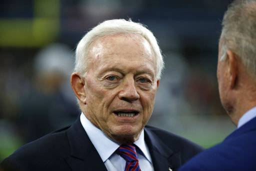 FILE - In this Nov. 23, 2017, file photo, Dallas Cowboys team owner Jerry Jones stands on the field as the team warms up before an NFL football game against the Los Angeles Chargers in Arlington, Texas. A person with knowledge of the situation says the NFL is exploring options to get more than $2 million in reimbursement for legal fees from Jones over his threat to derail Commissioner Roger Goodell's contract extension and his support of running back Ezekiel Elliott's fight to avoid a six-game suspension. The person spoke to The Associated Press on Monday, Feb. 26, 2018, on condition of anonymity because the matter has not being publicly addressed. (AP Photo/Ron Jenkins, File)