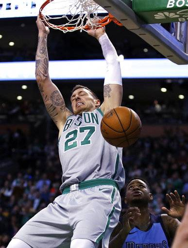 Boston Celtics forward Daniel Theis (27) slams-dunks during the second quarter of an NBA basketball game against the Memphis Grizzlies in Boston, Monday, Feb. 26, 2018. (AP Photo/Charles Krupa)