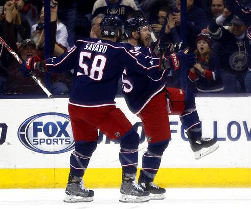 Columbus Blue Jackets forward Mark Letestu, right, celebrates his goal against the Washington Capitals with teammate David Savard during the first period of an NHL hockey game in Columbus, Ohio, Monday, Feb. 26, 2018. (AP Photo/Paul Vernon)