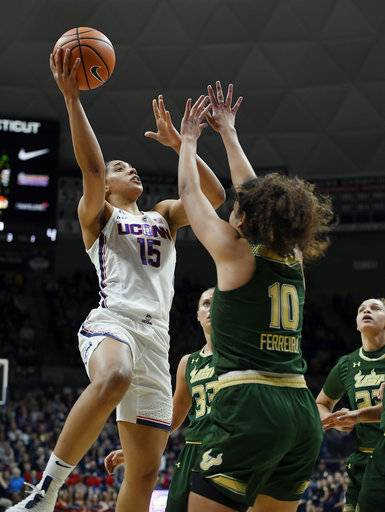 Connecticut's Gabby Williams, left, shoots over South Florida's Laura Ferreira, right, during the first half an NCAA college basketball game, Monday, Feb. 26, 2018, in Storrs, Conn. (AP Photo/Jessica Hill)