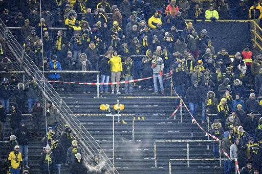 Dortmund's Ultras supporters on the famous South Tribune boycott the German Bundesliga soccer match between Borussia Dortmund and FC Augsburg in Dortmund, Germany, Monday, Feb 26, 2018. Thousands of supporters protest against Bundesliga matches on Mondays. (AP Photo/Martin Meissner)