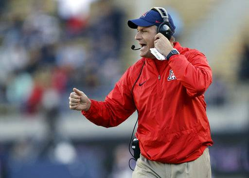 "FILE - In this Oct. 21, 2017, file photo, Arizona coach Rich Rodriguez yells from the sideline during the first half of the team's NCAA college football game against California in Berkeley, Calif. Rodriguez says a claim by his former administrative assistant seeking $7.5 million for sexual harassment is a ""sensationalized tale� created to extort him. His attorneys filed a response to the attorney general of Arizona on Monday, Feb. 26, 2018. (AP Photo/Marcio Jose Sanchez, File)"