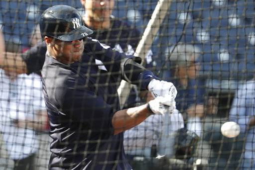 Seattle Seahawks quarterback Russell Wilson hits during batting practice before a baseball spring exhibition game against the Philadelphia Phillies, Monday, Feb. 26, 2018, in Tampa, Fla. (AP Photo/Lynne Sladky)