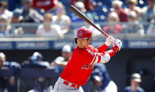 Los Angeles Angels' Shohei Ohtani bats during the first inning of a spring training baseball game against the San Diego Padres, Monday, Feb. 26, 2018, in Peoria, Ariz. (AP Photo/Charlie Neibergall)