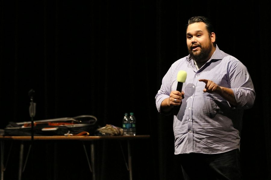 "Vijay Gupta, founder of Street Symphony and violinist with the Los Angeles Philharmonic, tells students Tuesday at Waubonsie Valley High School in Aurora not to base their entire self-definition on accomplishments. ""We are never going to feel like we are enough,"" he said, ""if we only define ourselves by what we do."""