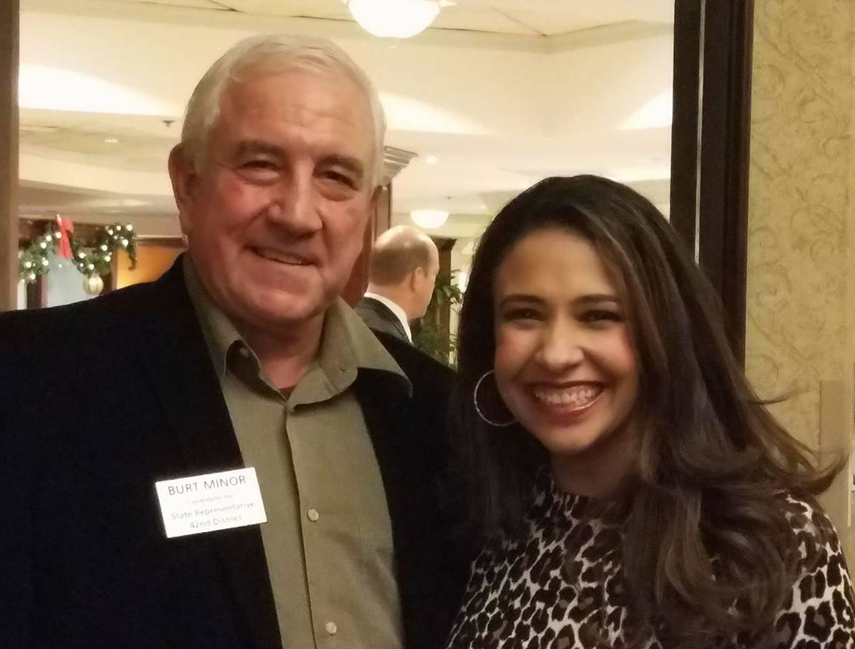Burt Minor and Erika Harold were smiling during a holiday party last December. But now Harold, who is running for attorney general in the March 20 Republican primary, has accused the legislative candidate of using inappropriate language during an October meeting.