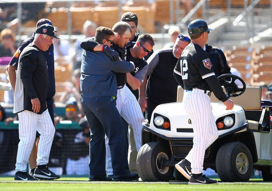 Chicago White Sox third baseman Jake Burger, here being helped after suffering a left Achilles tendon injury in Monday's spring training game in Glendale, Ariz., will miss the rest of the season. Burger will have surgery in Chicago on Thursday.