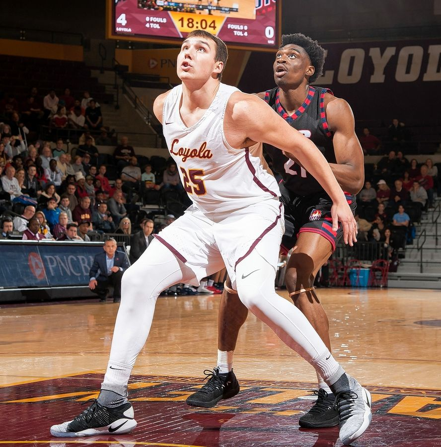 Loyola's Cameron Krutwig, a freshman center from Jacobs High School, blocks out in a game against Illinois-Chicago.