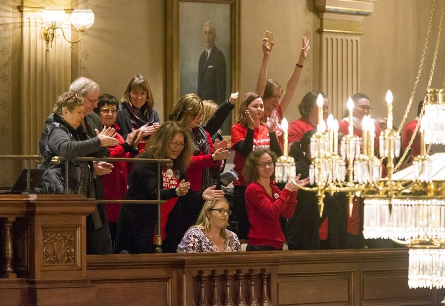 Members of the Illinois chapter of Moms Demand Action for Gun Sense react after SB 1657, a measure to regulate the licensing of gun dealers in the state, passes the Illinois House 64-52 Wednesday at the Capitol in Springfield.