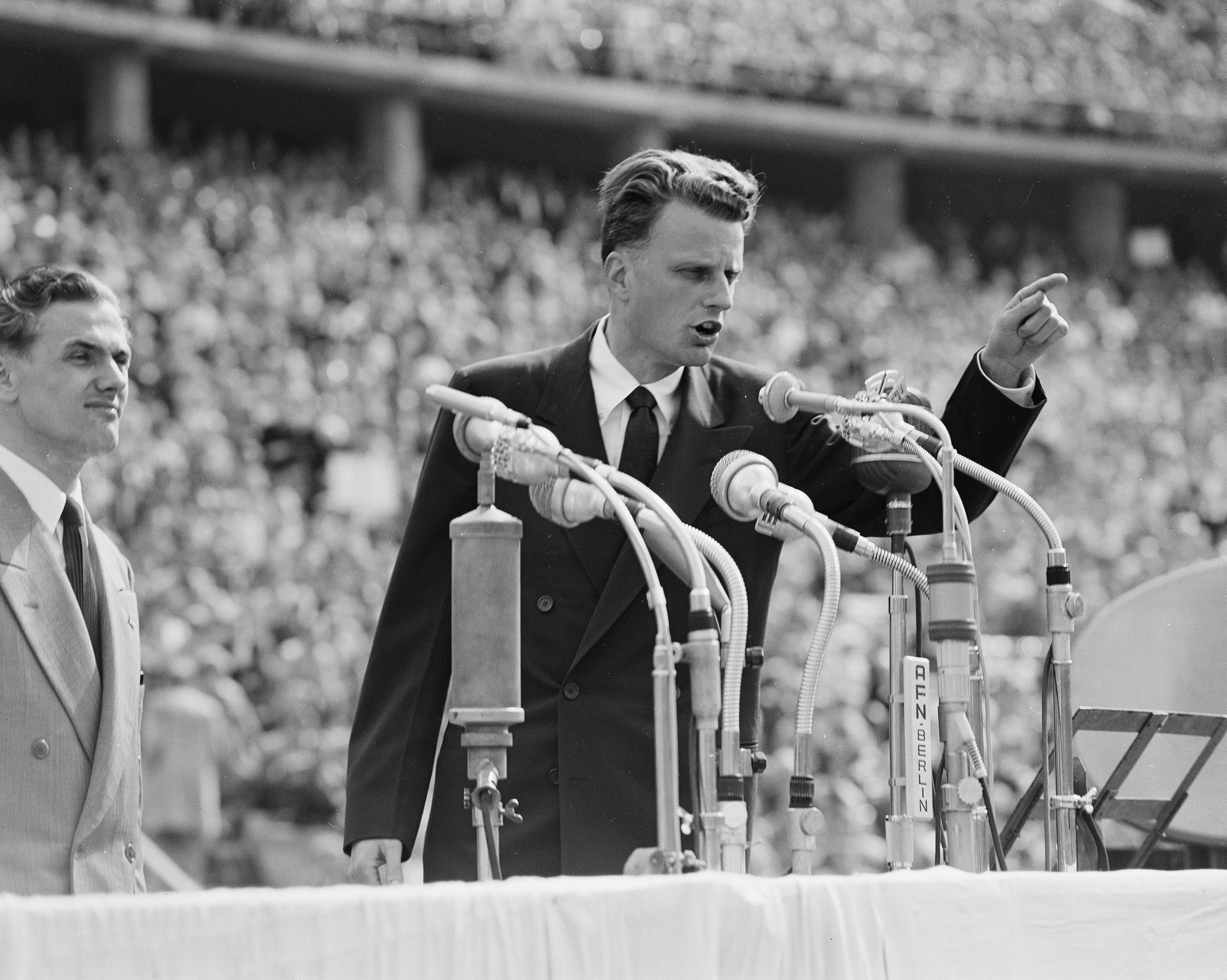 Evangelist Billy Graham addressed more than 100,000 Berliners at the Olympic Stadium in Germany on June 27, 1954.