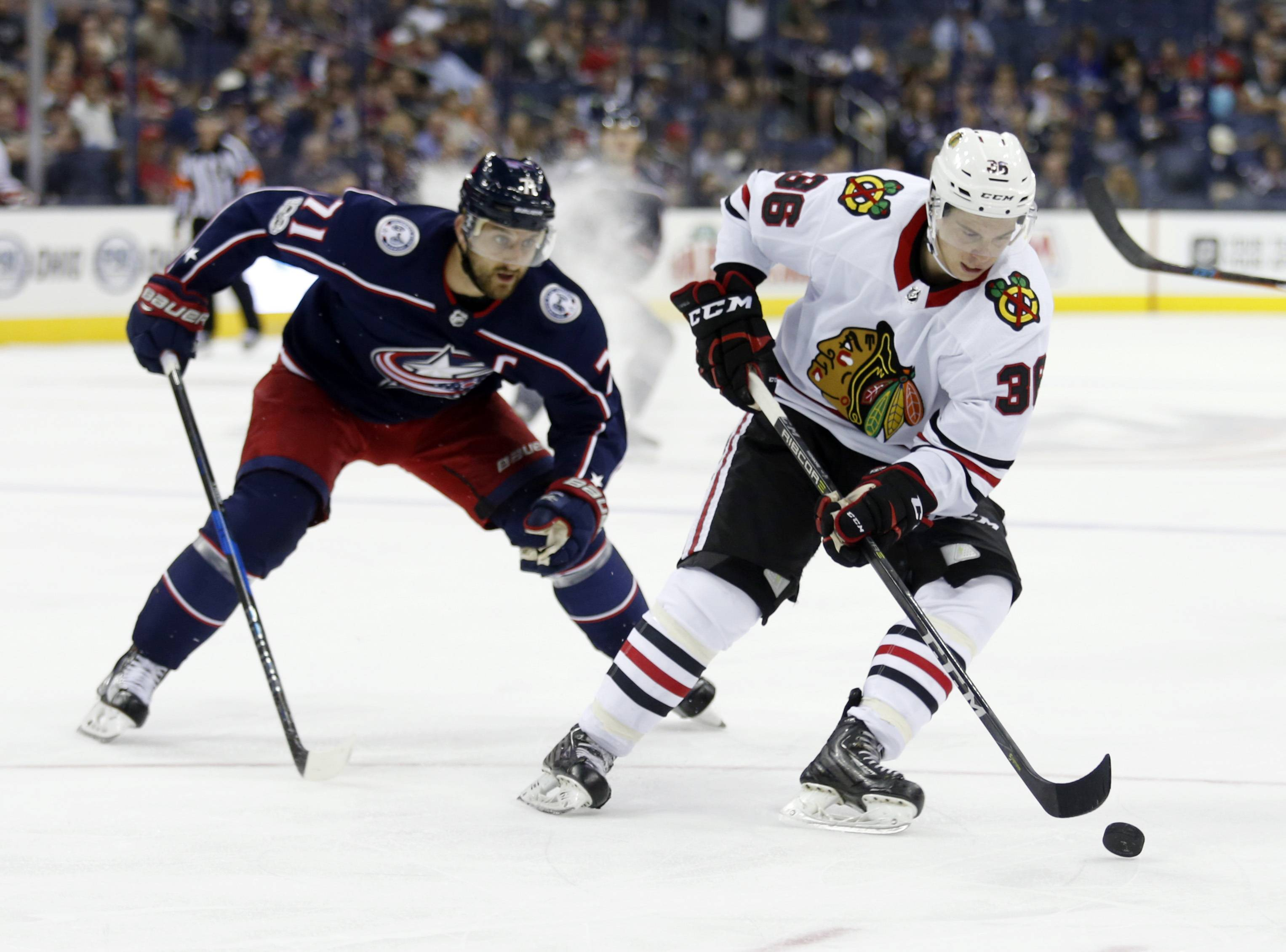 Chicago Blackhawks forward Matthew Highmore, right, controls the puck against Columbus Blue Jackets forward Nick Foligno during a 2017 preseason game. Highmore scored a rookie record 21 goals for the Rockford IceHogs and earned a call-up to the Chicago Blackhawks on Monday. Now we'll see if he can fill up the net in the NHL as well as he did in the AHL.