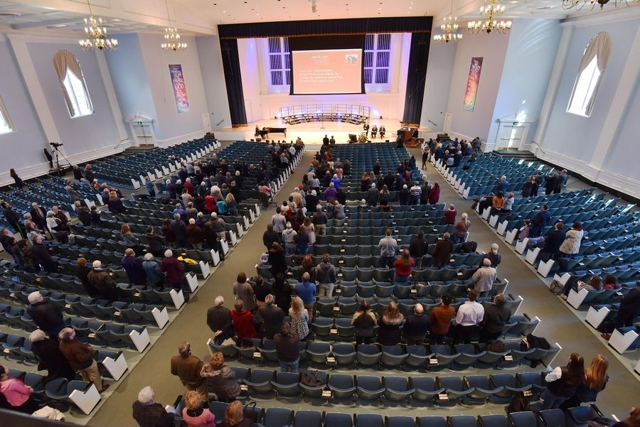 The Wheaton College gathering watched a simulcast of the Rev. Billy Graham funeral Friday in his home state of North Carolina.