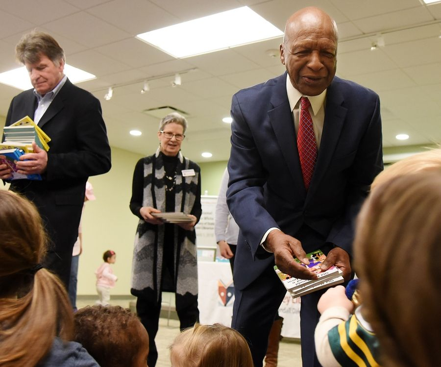 Secretary of State and State Librarian Jesse White passes out board books to kids Thursday morning at the Dundee Library in East Dundee. The books were given out on behalf of the Illinois Literacy Foundation.