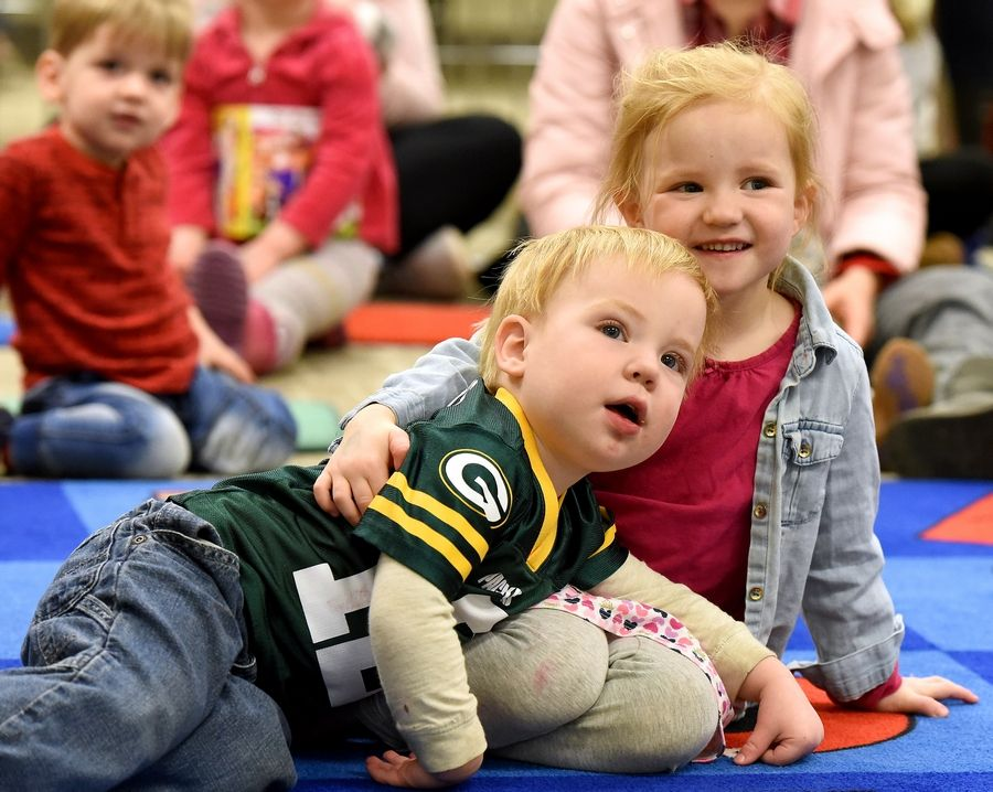 Nora Flickinger, 3, hugs her brother Ezra, 22 months, during Wonderful Ones Storytime Thursday at the Dundee Library. Secretary of State and State Librarian Jesse White passed out books to the kids during the program.
