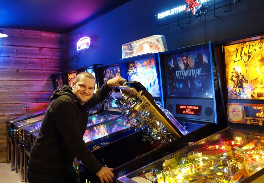 St. Charles resident Steve Bedi, who has 15 pinball machines in his gameroom, collects and repairs pinball machines.