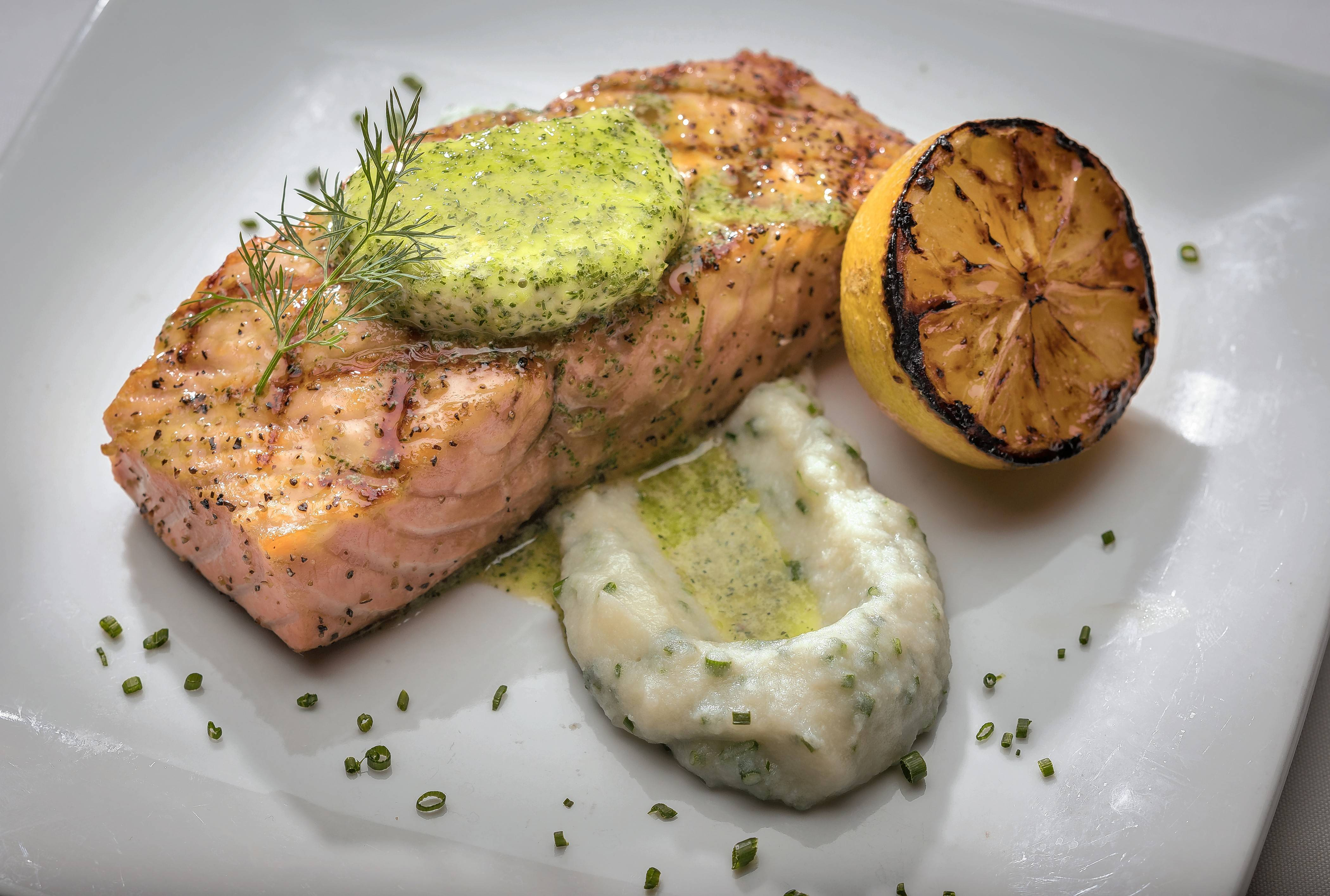 The Atlantic salmon grilled with lemon dill butter comes with a side of cauliflower mousse.